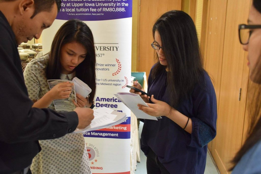 Students inquiring about further studies at the booths - HELP University, Berjaya University College of Hospitality and Manipal International University set up booths at the Ceremony. — at Federal Hotel, Kuala Lumpur.